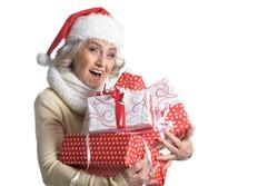 Portrait of smiling senior woman in Santa hat posing