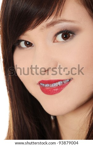 Portrait of smiling teen woman with correcting device on teeth
