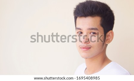 Portrait of smiling teenager boy. Emotional portrait of Handsome Caucasian Teen young man laughing and pointing fingers to you. Funny cute smiling child 15 year old cute Asian boy concept. Stockfoto ©