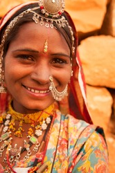 Portrait of smiling traditional Indian woman in sari dress, India people