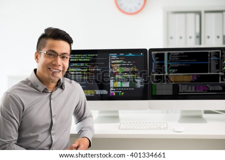 Portrait of smiling Vietnamese software engineer