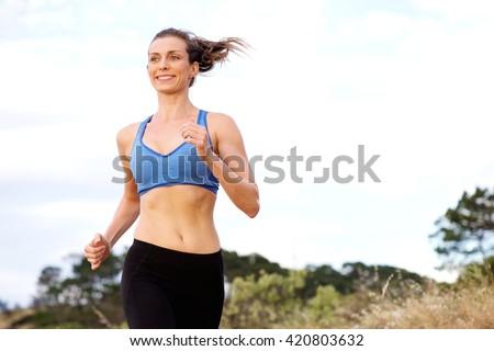 portrait of smiling woman...