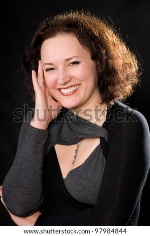 portrait of smiling woman on dark background