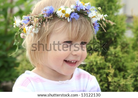 Portrait of smiling 2-3 years old girl with flower crown on her head