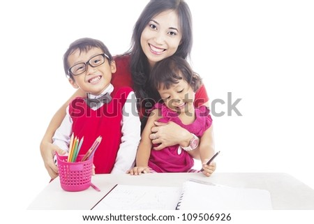 Portrait of smiling young asian mother with her children. shot in studio isolated on white