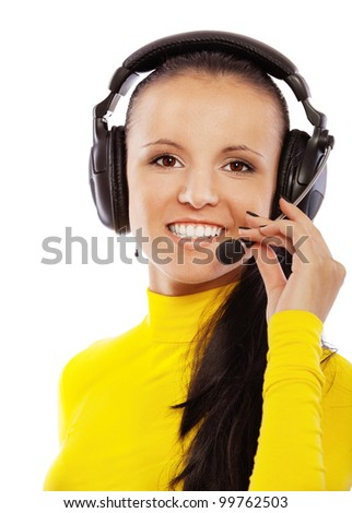 Portrait of smiling young beautiful woman in yellow turtleneck with headphones and microphone, isolated on white background.