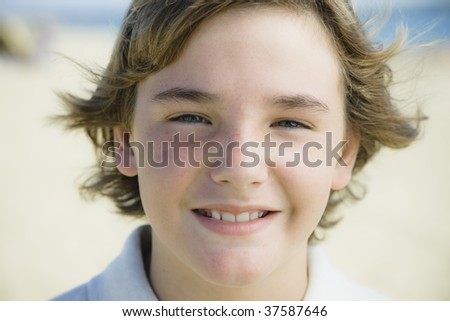Portrait of Smiling Young Boy at the Beach