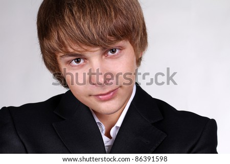 Portrait of smiling young business man looking at camera