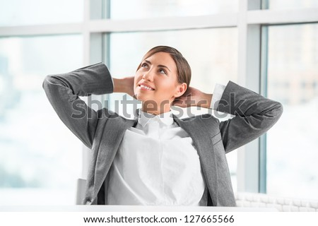 Portrait of smiling young business woman relaxing at office