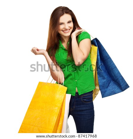 Portrait of smiling young female with shopping bags against white background