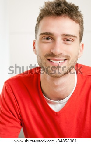 Portrait of smiling young man at home