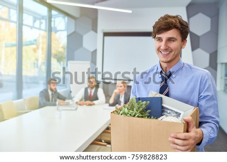 Portrait of smiling young man holding box of personal belongings being hired to work in business company, copy space #759828823