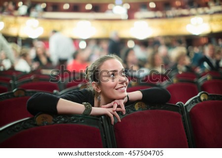 Portrait of smiling young woman in auditorium of opera teatre Zdjęcia stock ©