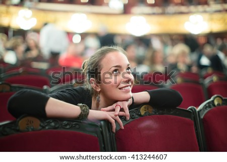 Portrait of smiling young woman in auditorium of theatre  Zdjęcia stock ©