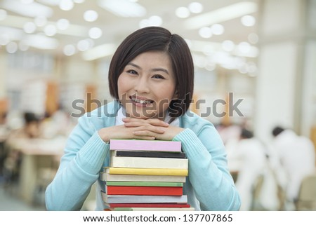 Portrait of Smiling Young Woman in Library