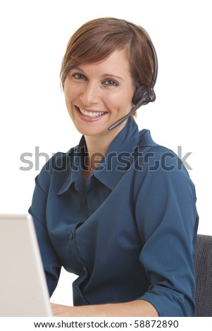 Portrait of smiling young woman telemarketer at computer desk