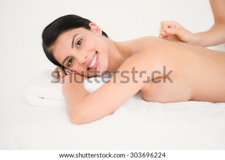 Portrait of smilling woman in an acupuncture therapy at the health spa