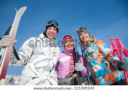 Portrait of smilling young couple in winter park