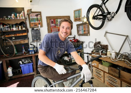 Portrait of smilng craftsman in bike workshop