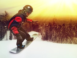 Portrait of snowboarder doing extreme trick on the mountain.