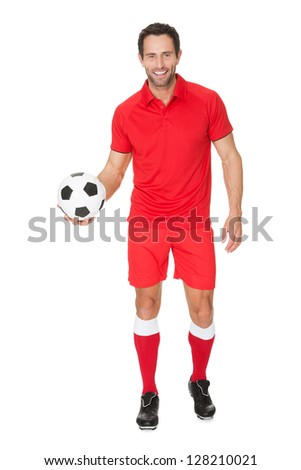 Portrait of soccer player. Isolated on white