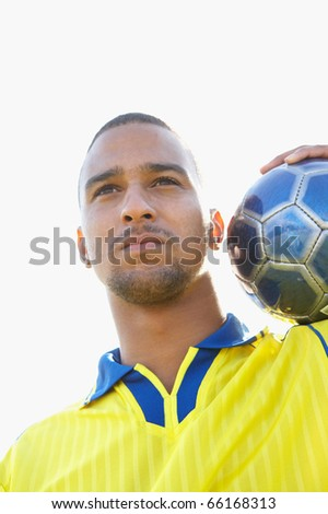 Portrait of soccer player with ball on shoulder