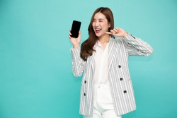Portrait of Southeast Asian business woman showing or presenting mobile phone application on hand isolated on green background, One person of horizontal orientation, Blank screen smartphone concept