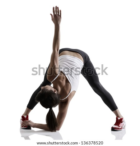 portrait of sport girl doing yoga stretching exercise, studio shot in silhouette technique over white background