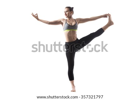 Portrait of sporty beautiful young brunette woman in sportswear bra and black pants working out, doing Utthita Hasta Padangustasana, Extended Hand-To-Big-Toe pose, studio full length, isolated