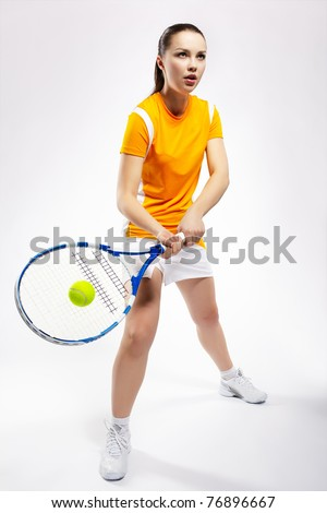 portrait of sporty girl tennis player with racket