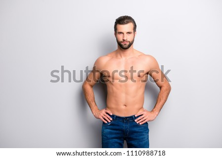 Portrait of sporty handsome masculine virile attractive proud concentrated confident muscular with naked nude torso man keeping holding hands on hips isolated on gray background
