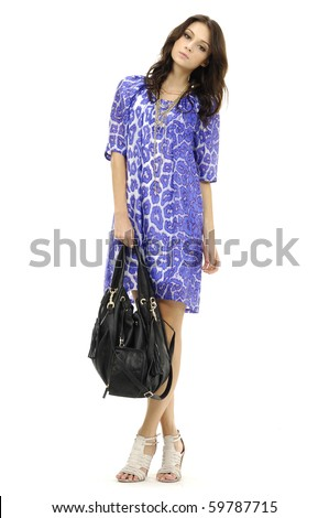 portrait of standing young woman with modern bag. Isolated