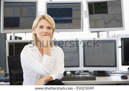 Portrait Of Stock Trader In Front Of Computer Monitors - stock photo