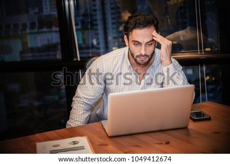 Portrait of stress sad business man working late at night time in office. Business man work hard lifestyle stress burnout overtime office syndrome, work from home, quarantine coronavirus concept.