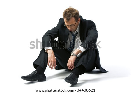 Portrait of stressed businessman left to the mercy of fate