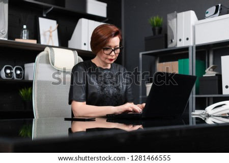 Portrait of strict businesswoman with laptop in stylish office #1281466555