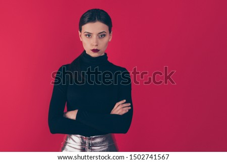 Portrait of strict pensive lady cross her hands stare true leader in her work career wear black turtleneck silver glowing dress mini skirt isolated over red color background #1502741567