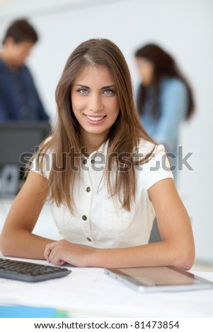 Portrait of student using electronic tablet in class