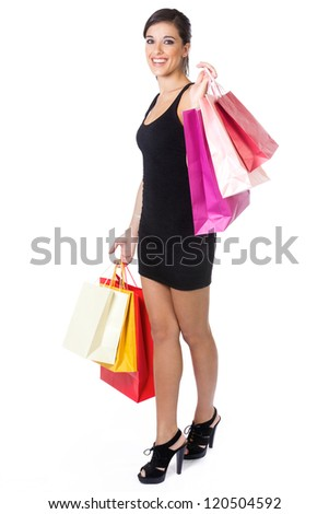 Portrait of stunning young woman carrying shopping bags against white background