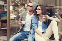 Portrait of stylish couple at outside of cafe