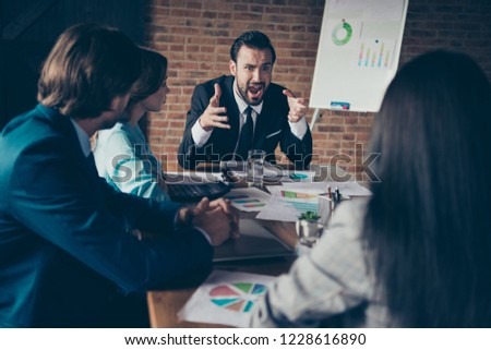 Portrait of stylish elegant classy angry chairman company founder director employer having disagreement with employees at workplace workstation