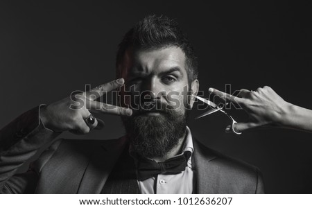 Portrait of stylish man beard. Bearded man, bearded male. Barber scissors, barber shop. Vintage barbershop, shaving. Portrait of unshaven mans. Black and white.