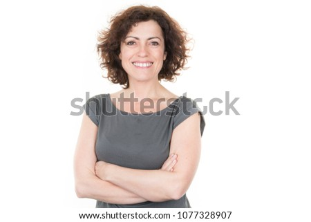 portrait of stylish pretty woman smiling in green grey t-shirt on white studio background, isolated, natural look, curly brown hair, crossed arms #1077328907