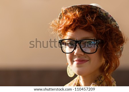 Portrait of stylish young hipster outdoors at sunset - stock photo