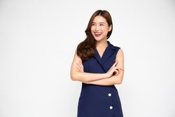 Portrait of successful business asian women in blue dress with arms crossed and smile isolated over white background