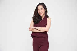 Portrait of successful business asian women in dark red dress with arms crossed and smile isolated over white background, Young businesswoman smiling and looking at camera, Happy feeling concept
