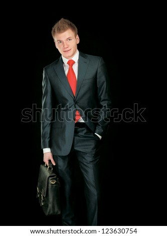 Portrait of successful business man with bag, isolated on white background