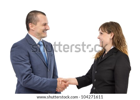 Portrait of successful business people shaking hands on a deal on a white background