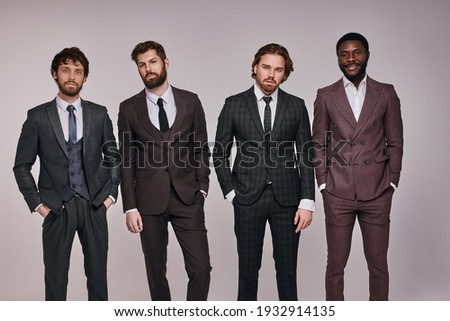 Portrait of successful business team in fashionable suits or tuxedo, bearded males in formal wear are preparing for business meeting. success, people, business, career concept ストックフォト ©
