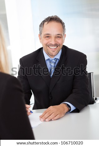 Portrait of successful businessman at the interview